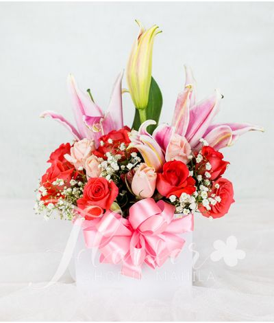 Charming Pink Flowers in a Round Box