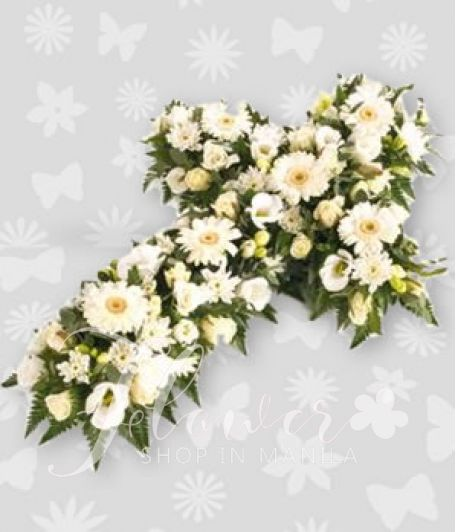 Casket of cross white flowers