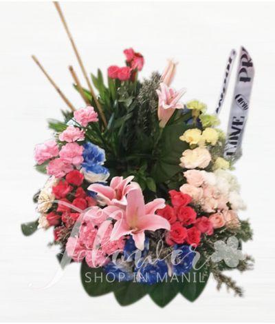 Vibrant Mixed Urn Flower Arrangment